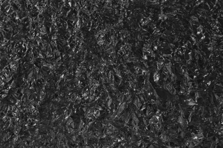 Photo for Shiny black grey foil metal texture, abstract wrapping paper with high resolution for background. - Royalty Free Image