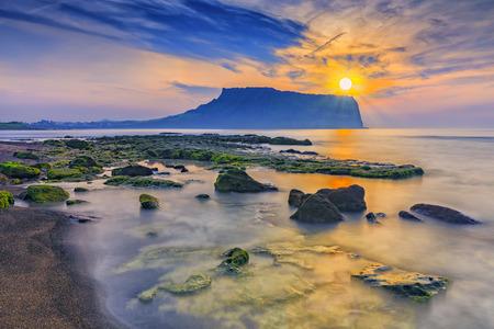 Foto de Sunrise at Seongsan Ilchulbong, Jeju island, South Korea. - Imagen libre de derechos