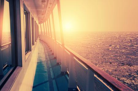 Photo pour Cruise ship in sea at sunset. Beautiful summer seascape. Creative vintage filter, retro effect - image libre de droit