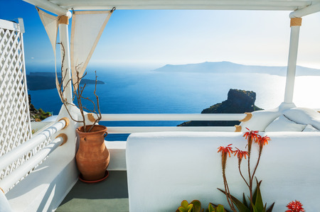 Photo for Beautiful terrace with sea view at sunset. White architecture on Santorini island, Greece. - Royalty Free Image