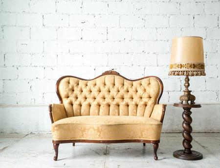 Photo pour Classical style Armchair sofa couch in vintage room with desk lamp - image libre de droit