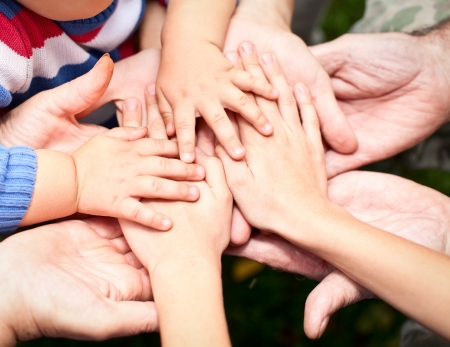Photo for Family holding hands together closeup - Royalty Free Image