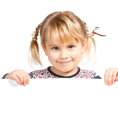 Photo for Cute little girl holding a white board - Royalty Free Image
