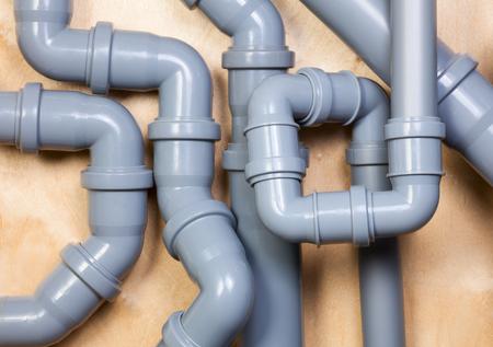 Photo pour Chaotic installation of  PVC sewer pipes - image libre de droit