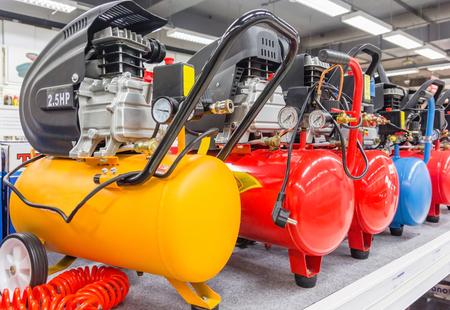 Foto de Many Air compressors pressure pumps closeup photo - Imagen libre de derechos