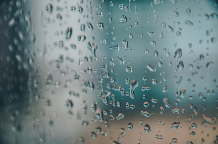 Foto de Wallpaper of rain drops or water drops on the glass, Vintage background by rainy drop on window, Rainy day with raindrop on the glass, Texture of water droplet on window glass. - Imagen libre de derechos