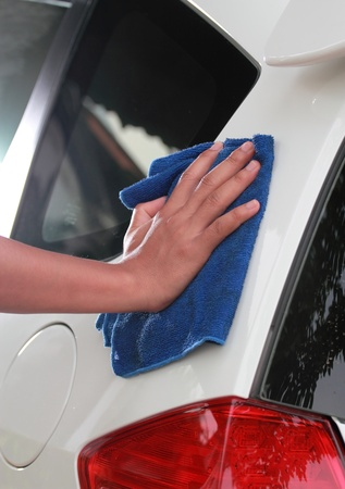 Hand are Cleaning car
