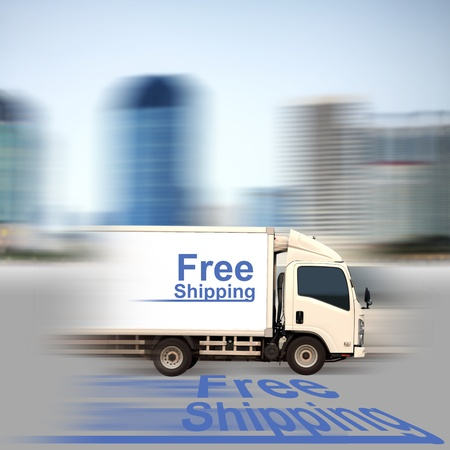 White van with Free Shipping and office buildings in the city