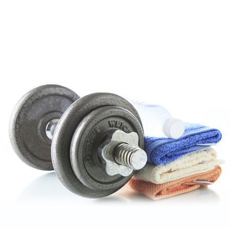 Foto de Dumbbell with water and towel - Imagen libre de derechos