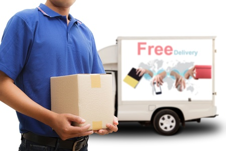 Photo for Delivery man with free delivery car - Royalty Free Image