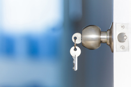 Foto de Open door with keys, key in keyhole - Imagen libre de derechos
