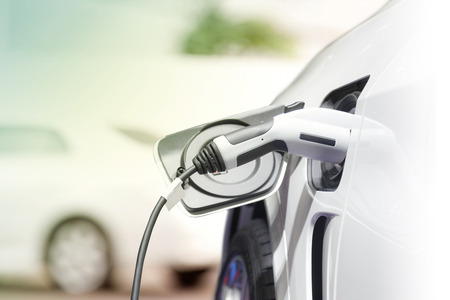 Foto per Charging an electric car, Future of transportation - Immagine Royalty Free