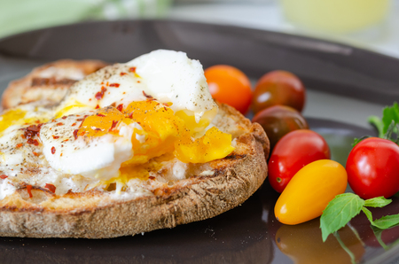 Photo for Turkish breakfast with eggs, toasted bread, colorfull tomatoes, parsley on black plate. - Royalty Free Image