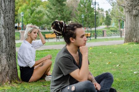 Foto de The young girl is looking towards the man with a broken heart. - Imagen libre de derechos