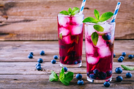 Photo for Blueberry ice sangria with  mint in glasses on wooden background - Royalty Free Image