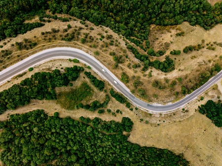Photo pour Aerial above view of a rural landscape with a curvy road running through it in Greece. Drone photography - image libre de droit