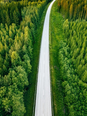 Photo pour Aerial view from above of country road through the green summer forest in summer Finland. drone photography - image libre de droit