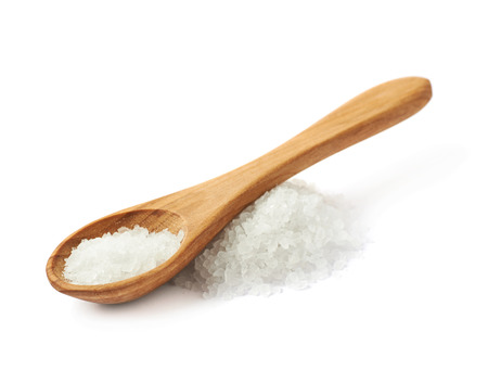 Photo pour Wooden spoon over the pile of white rock salt, composition isolated over the white background - image libre de droit