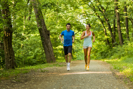 Photo pour Young people jogging and exercising in nature - image libre de droit