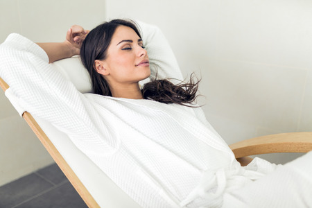 Photo for Portrait of a beautiful young  healthy woman relaxing in a robe - Royalty Free Image