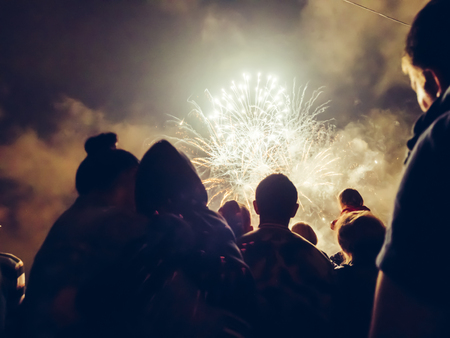 Photo for Crowd wathcing fireworks and celebrating - Royalty Free Image