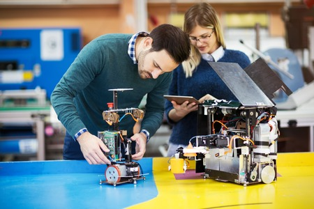 Photo pour Engineering and robotics student working on project - image libre de droit