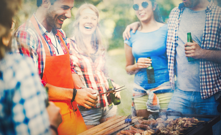 Photo for Friends having a barbecue party in nature  while having a blast - Royalty Free Image