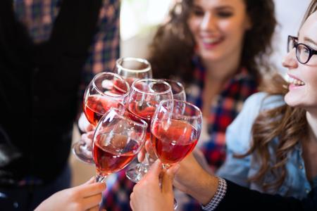 Photo pour Wine tasting event by happy people concept - image libre de droit