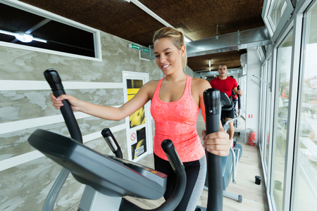 Foto für Young beautiful woman doing cardio in gym - Lizenzfreies Bild