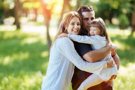 Foto de Family happy outdoors with adopted child - Imagen libre de derechos