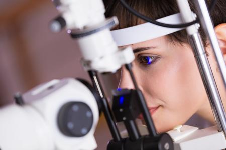 Foto de Optometrist examining patient in modern ophthalmology clinic - Imagen libre de derechos