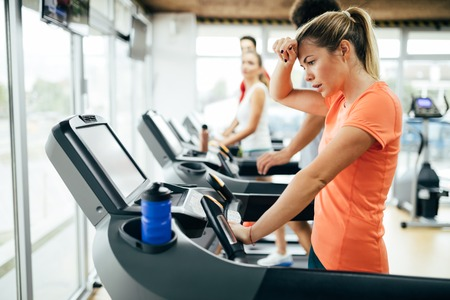 Foto per Young attractive woman doing cardio training in gym - Immagine Royalty Free