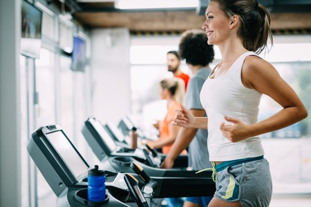 Foto per Group of friends exercising on treadmill machine - Immagine Royalty Free