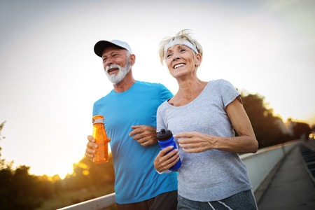 Foto per Beautiful sporty mature couple styaing fit with sport - Immagine Royalty Free