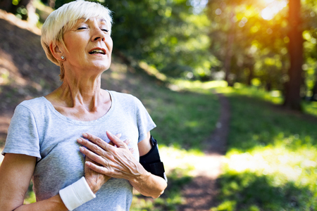 Photo for Mature woman athlete have sore left chest pain dizziness - Royalty Free Image