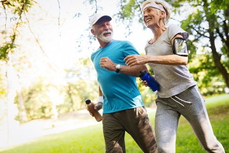 Photo pour Happy senior people running to stay helathy and lose weight - image libre de droit