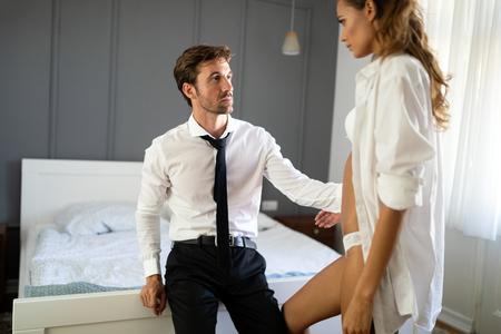 Photo pour Passionate couple is having sex in a bedroom. Portrait of passion, pleasure, sex, relationship. - image libre de droit