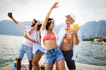 Photo for Group of friends having fun at summer party and drinking cocktail - Royalty Free Image