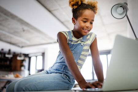 Photo pour Game, study, fun concept. Happy children spending time with notebook and modern technology. - image libre de droit