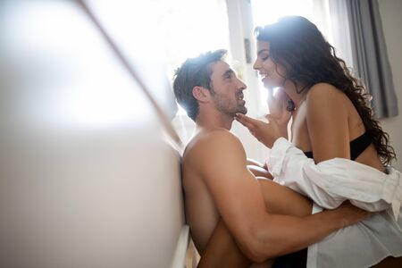 Photo pour Young sexy hot couple in love hugging and kissing - image libre de droit