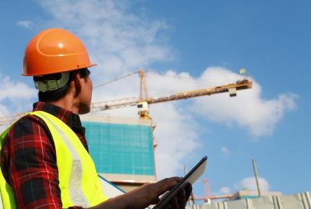 Photo pour builder worker activity with digital tablet on construction site - image libre de droit