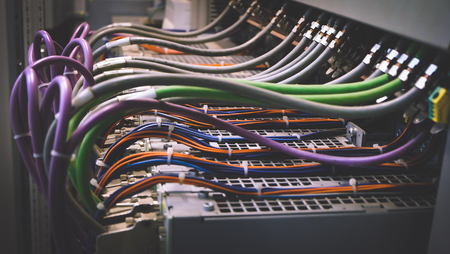 Foto de Colorful Wires PLC Cable in Control Panel System - Imagen libre de derechos