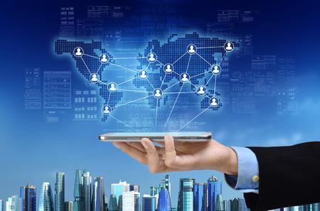 Foto de A visual concept of a virtual  business and a global social network on a  smart phone gadget - Imagen libre de derechos