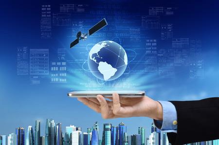 Photo pour A concept of global internet connection on a smart phone with futuristic city background - image libre de droit