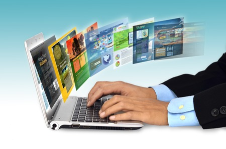 Photo pour Businessman hand browsing internet websites on his laptop - image libre de droit