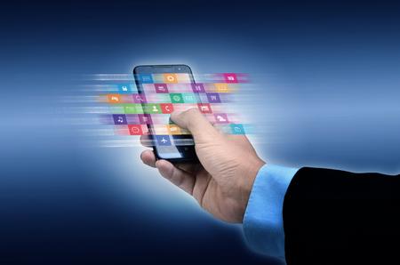 Photo pour Internet concept. Businessman using a smart phone to browse or use application on line - image libre de droit