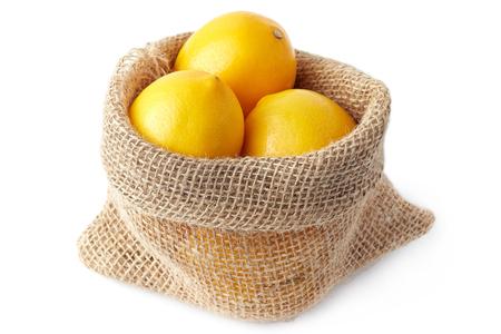 Photo for Lemons in burlap sack isolated on white background - Royalty Free Image