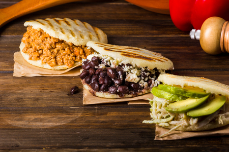 Photo pour Three types of arepas, Latin American food on wood table - image libre de droit
