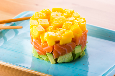 Photo for salmon tartar, avocado and mango, mix of latin and japanese food - Royalty Free Image