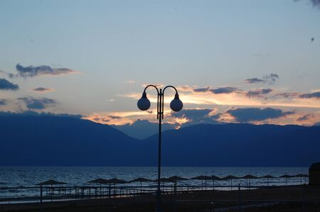Photo pour Sunset over lake Prespa in Macedonia - image libre de droit